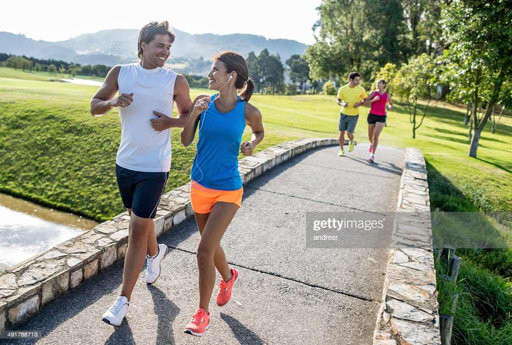 Athletic people running outdoors