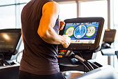 Athletic Runner Running on Treadmill in  Gym