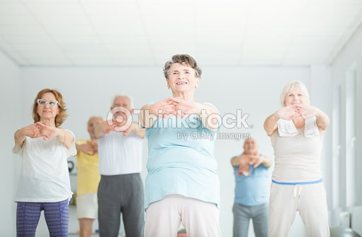 Athletic senior people stretching : Stock Photo