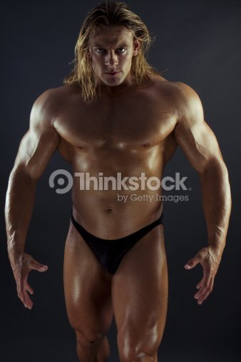 Sexy muscle girl with blonde hair think