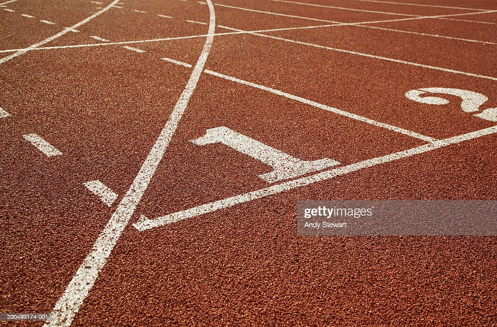 Athletic track, lane one in foreground : Stock Photo