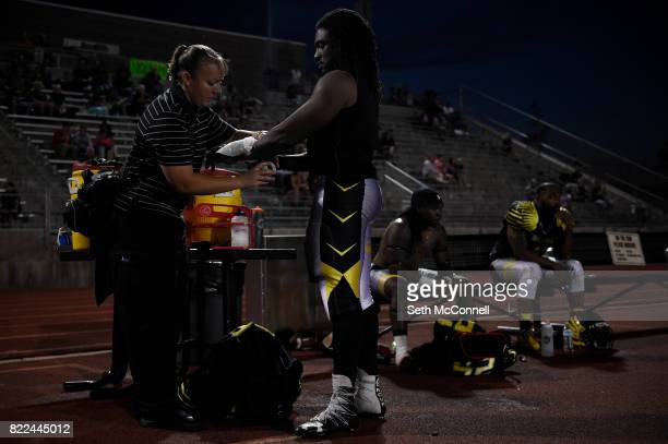 Athletic Trainer Cayenne Schmidt tapes a bag of ice on the wrist of Weldon Guillory of the Colorado Greyhawks late in the fourth quarter against the...