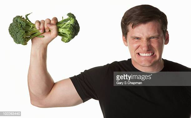 Athletic trainer pumping broccoli