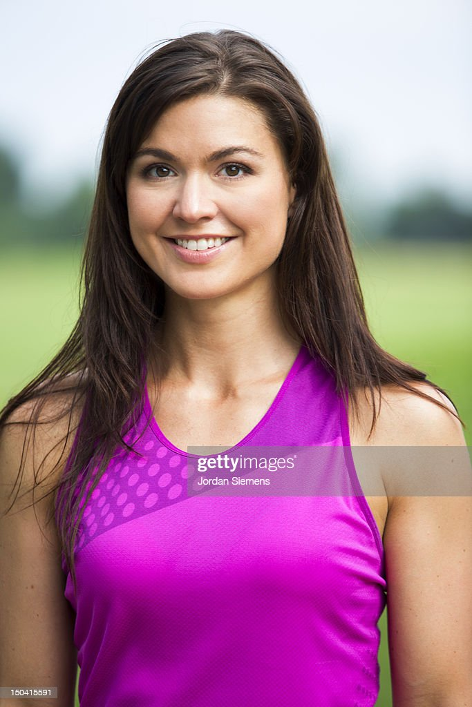 Athletic woman in a pink tank top. : Stock Photo