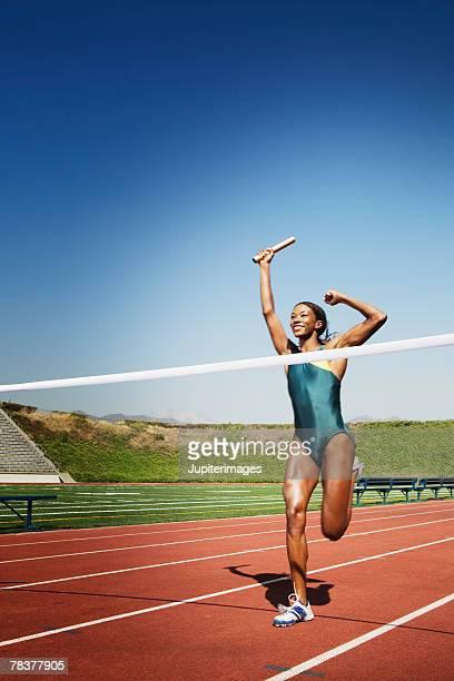 Athletic woman winning race