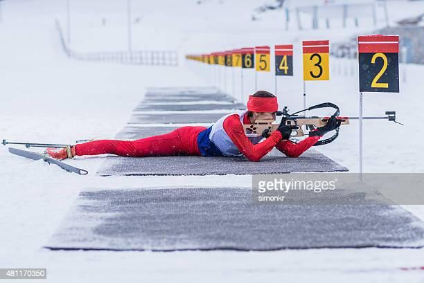 Athletic woman with biathlon rifle