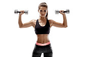 Athletic woman with dumbbells doing sport exercise, isolated on white background. Horizontal. Copy space