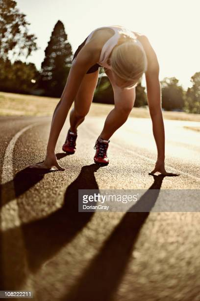 Athletic Young Woman on Track About to Run