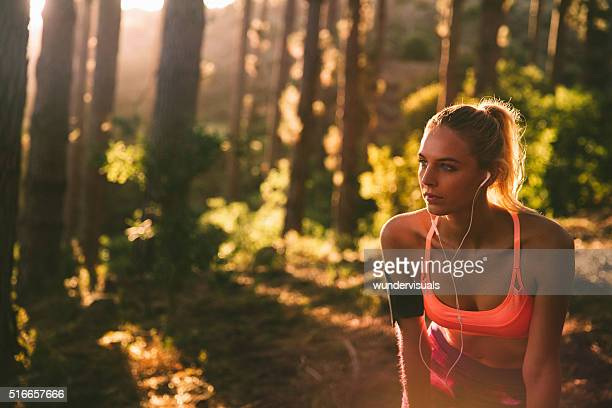 Athletic young woman taking a break from workout