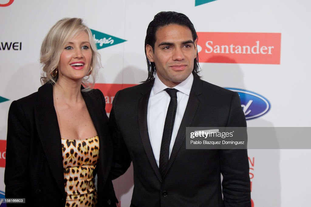 Athletico Madrid's football player <a gi-track='captionPersonalityLinkClicked' href=/galleries/search?phrase=Radamel+Falcao&family=editorial&specificpeople=3022104 ng-click='$event.stopPropagation()'>Radamel Falcao</a> (R) and wife Lorelei Taron (L) attend 'As Del Deporte' Awards 2012 at The Westin Palace Hotel on December 10, 2012 in Madrid, Spain.