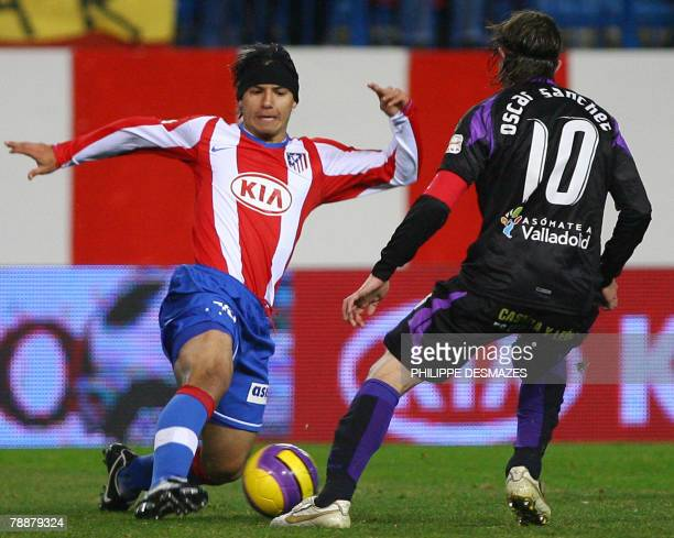 Athletico Madrid's Kun Aguero fights for the ball with Valladolid's Oscar Sanchez during their Spanish King's Cup football match at the Calderon...