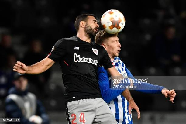 Athletic's defender Mikel Balenziaga and Berlin's German midfielder Mitchell Weiser both go to head the ball during the UEFA Europa League group J...