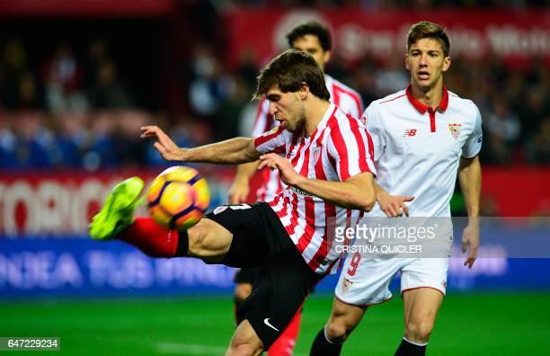 Athletic's defender Yeray Alvarez kicks the ball past Sevilla's Argentinian forward Luciano Vietto during the Spanish league football match Sevilla...
