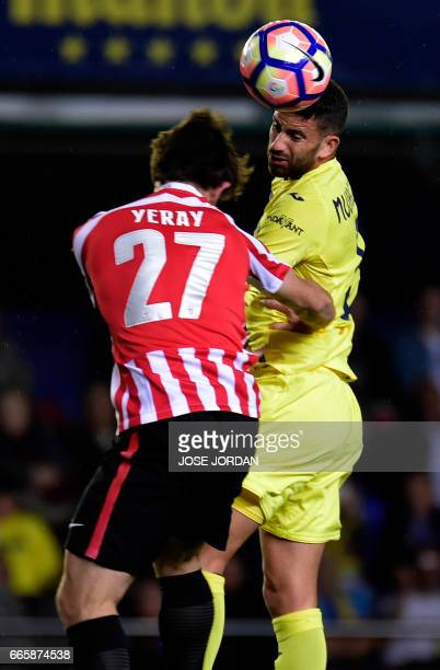 Athletic's defender Yeray Alvarez vies with Villarreal's Argentinian defender Mateo Musacchio during the Spanish league football match Villarreal CF...