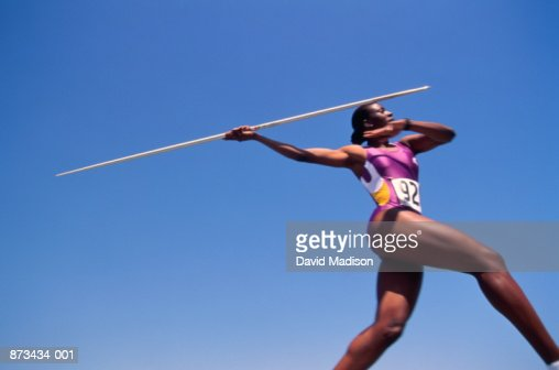 Athletics, javelin thrower in action, low angle view : Stock Photo