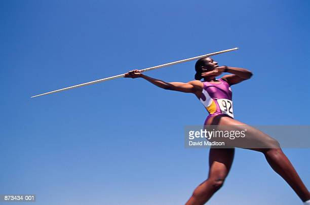 Athletics, javelin thrower in action, low angle view