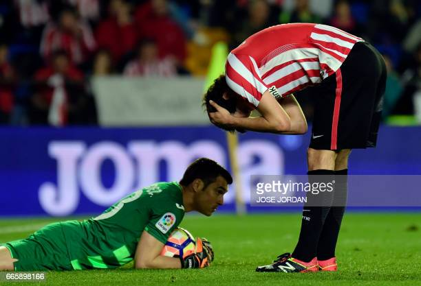 Athletic's midfielder Mikel San Jose bends in front of Villarreal's goalkeeper Andres Fernandez after missing an attempt on goal during the Spanish...