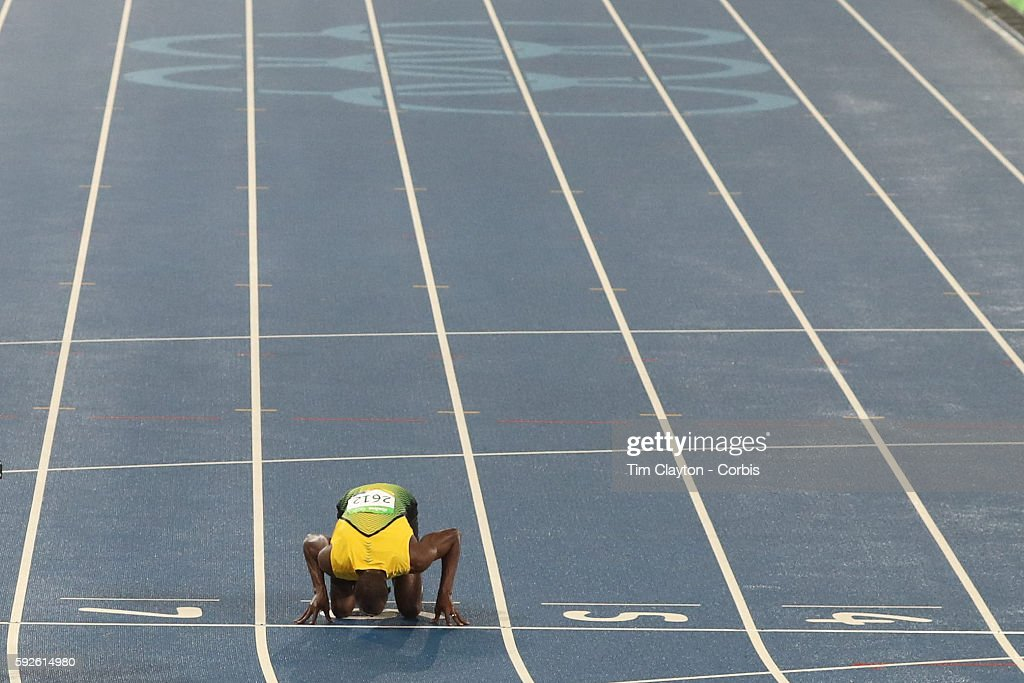 Day 9 Usain Bolt of Jamaica kisses the number six lane which he ran in to win the Men's 200m Final at the Olympic Stadium on August 18 2016 in Rio de...