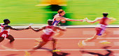 Athletics, relay teams passing batons (blurred motion)