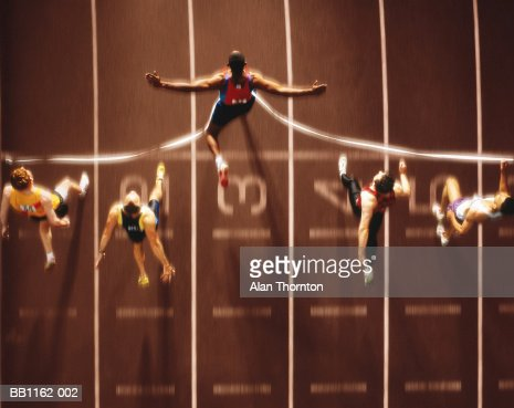 Athletics, runners at finish line, overhead view (Digital Composite) : Stock Photo
