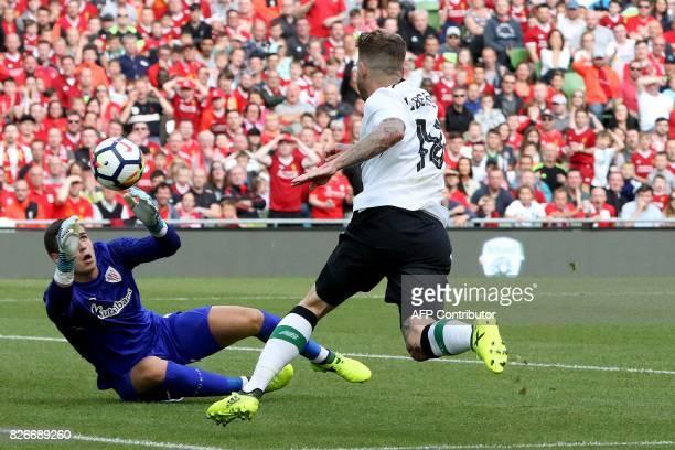Athletic's Spanish goalkeeper Kepa Arrizabalaga saves as Liverpool's Spanish defender Alberto Moreno closes in during the preseason friendly football...
