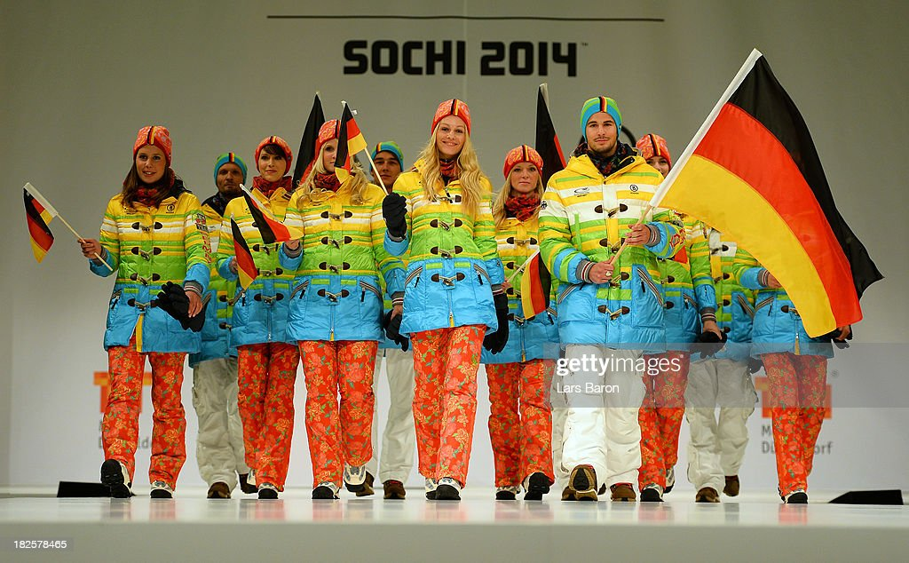 Athlets are seen on the catwalk during the German Olympic and Paralympic team kit presentation at Messe Duesseldorf on October 1, 2013 in Dusseldorf, Germany.