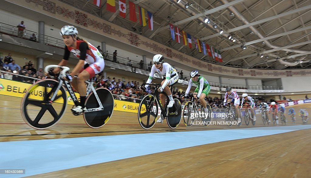 Athlets compete in the Womens' 25 km Point Race event of the UCI Track Cycling World Championships in Minsk on February 23, 2013. AFP PHOTO / ALEXANDER NEMENOV