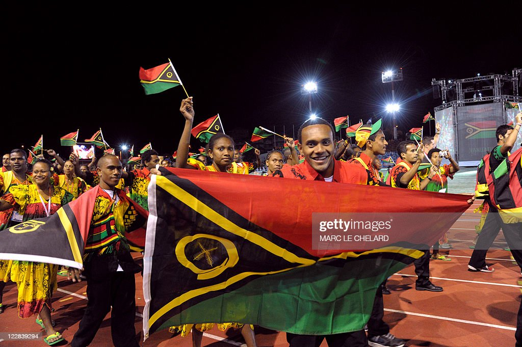 Athlets of the Vanuatu delegation wave flags as they attend the Opening Ceremony for the 14th Pacific Games on August 27 in the French South Pacific...