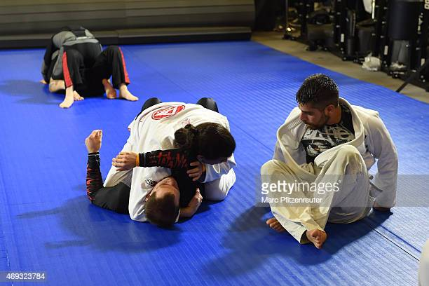 Athletse are training Brazilian Jiu Jitsu during the FIBO 2015 on April 11 2015 in Cologne Germany FIBO is the leading international trade show for...
