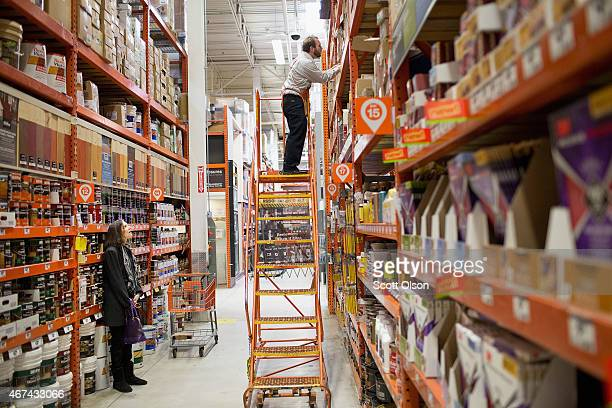 Athony Ross helps Linda Lepp search for an item at a Home Depot store on March 24 2015 in Chicago Illinois The Labor Department reported the...