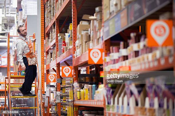 Athony Ross searches for an item for a customer at a Home Depot store on March 24 2015 in Chicago Illinois The Labor Department reported the...