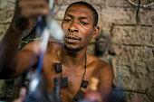 Athuman Midevu traditional healer and magician of Luguru tribe from Morogoro region in Tanzania prepares himself for a ritual in Visiga Kwa Kipofu...