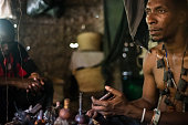 Athuman Midevu traditional healer and magician of Luguru tribe from Morogoro region in Tanzania uses the ritual mirror to identify all problems of...