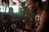 Athuman Midevu traditional healer and magician of Luguru tribe from Morogoro region in Tanzania looks at the ritual mirror to identify all problems...