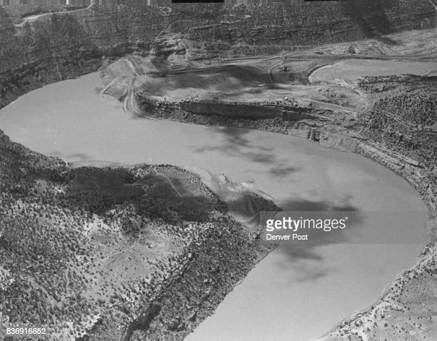 Athwart the San Juan River 39 miles northeast of Farmington N M the Bureau of Reclamation is building one of its biggest earthfill dams the Navajo a...