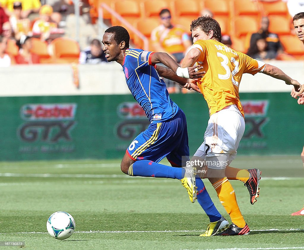 Atiba Harris #16 of the Colorado Rapids fends off Bobby Boswell #32 of the Houston Dynamo as he brings the ball up the field at BBVA Compass Stadium on April 28, 2013 in Houston, Texas.