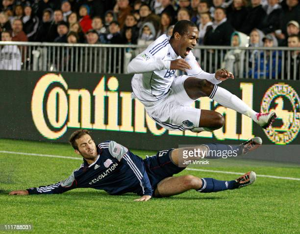Atiba Harris of the Vancouver Whitecaps FC grimaces in pain after being tripped up by AJ Soares of the New England Revolution during their MLS game...