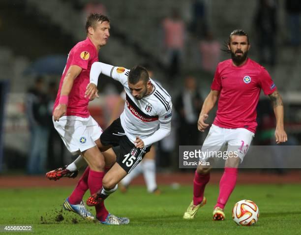 Atiba Hutchinson in action with Dorin Goian of Astreas Tripolis during their UEFA Europa League Group C match Besiktas JK v Asteras Tripolis FC at...
