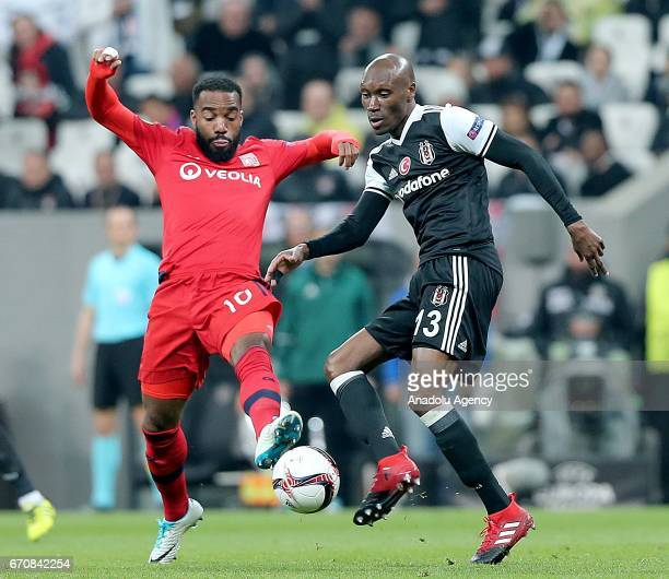 Atiba Hutchinson of Besiktas and Alexandre Lacazette of Olympique Lyon vie for ball during the UEFA Europa League quarter final second match between...