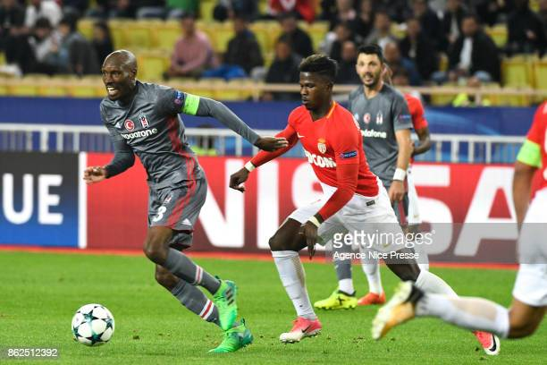 Atiba Hutchinson of Besiktas and Keita Balde of Monaco during the UEFA Champions League match between AS Monaco and Besiktas at Stade Louis II on...