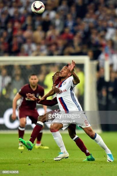 Atiba Hutchinson of Besiktas Corentin Tolisso of Lyon during the Uefa Europa League quarter final first leg match between Olympique Lyonnais Lyon and...