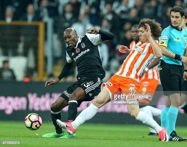 Atiba Hutchinson of Besiktas in action against Renan Rodrigues Da Silva of Adanaspor during the Turkish Spor Toto Super Lig football match between...
