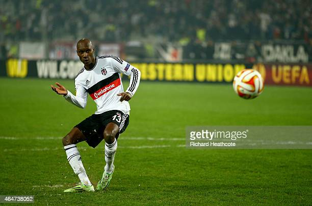 Atiba Hutchinson of Besiktas scores his penalty in the shoot out during the 2nd leg of the UEFA Europa League Round of 32 match between Besiktas and...