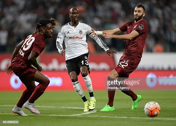 Atiba Hutchinson of Besiktas vies for the ball with Luis Pedro Cavanda and Mustafa Yumlu of Trabzonspor during the Turkish Spor Toto Super League...