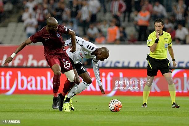 Atiba Hutchinson of Besiktas vies for the ball with Stephane M'bia Etoundi of Trabzonspor during the Turkish Spor Toto Super League football match...