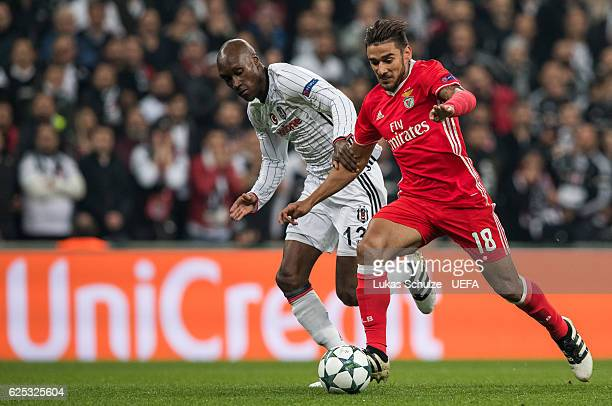 Atiba Hutchinson of Istanbul and Eduardo Salvio of Benfica in action during the UEFA Champions League match between Besiktas JK and SL Benfica at...