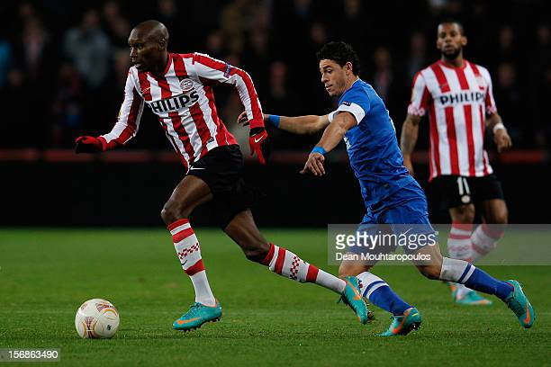Atiba Hutchinson of PSV and Victor Giuliano of Dnipro battle for the ball during the UEFA Europa League Group F match between PSV Eindhoven and FC...