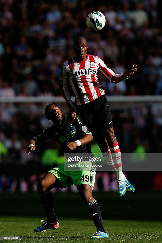 <a gi-track='captionPersonalityLinkClicked' href=/galleries/search?phrase=Atiba+Hutchinson&family=editorial&specificpeople=850921 ng-click='$event.stopPropagation()'>Atiba Hutchinson</a> of PSV beats <a gi-track='captionPersonalityLinkClicked' href=/galleries/search?phrase=Ryan+Babel&family=editorial&specificpeople=543539 ng-click='$event.stopPropagation()'>Ryan Babel</a> of Ajax to the header during the Eredivisie match between PSV Eindhoven and Ajax Amsterdam at Philips Stadion on April 14, 2013 in Eindhoven, Netherlands.