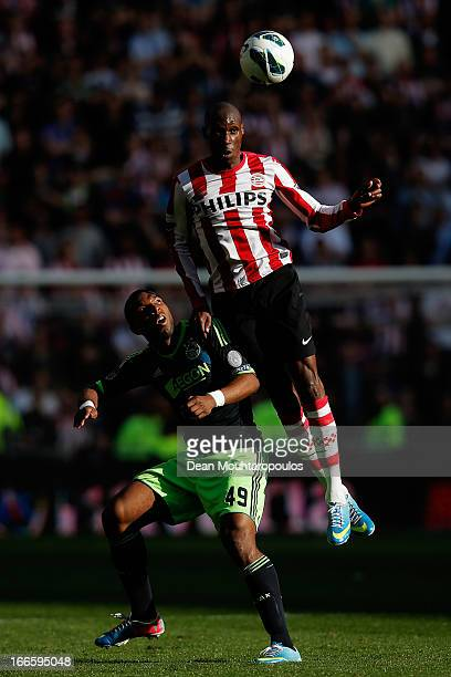Atiba Hutchinson of PSV beats Ryan Babel of Ajax to the header during the Eredivisie match between PSV Eindhoven and Ajax Amsterdam at Philips...