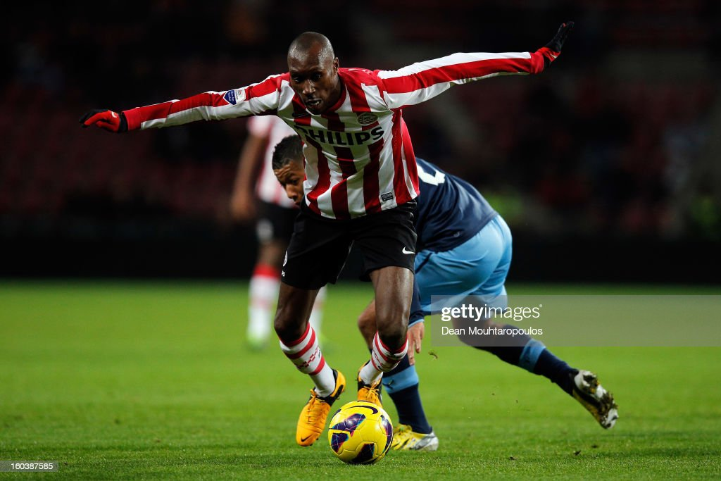 Atiba Hutchinson of PSV gets past Tonny Vilhena of Feyenoord during the KNVB Dutch Cup match between PSV Eindhoven and Feyenoord Rotterdam at Philips Stadion on January 30, 2013 in Eindhoven, Netherlands.